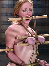 Busty blonde beauty is bound, gagged and tormented with water.