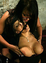 Two busty brunettes in BDSM sex action featuring Eva Angelina