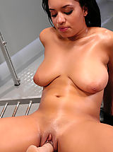 Hot black babe with huge natural tits gets machine fucked.