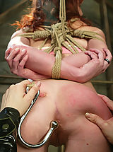 Redhead in tough bondage and lesbian domination