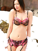 Beautiful brunette does a sexy strip from her office outfit in the Bulgarian snow.