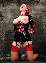 Busty girl in latex dominated and bound.