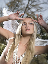 Beautiful naked blonde with the wings