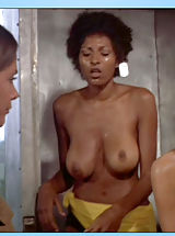 Pam Grier unleashes her huge jugs and completely circular buns in bed
