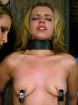 Hot young blonde in metal restraint and strapon fucked.
