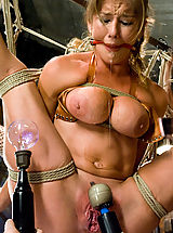 Two hot babes get tied together, shocked, and made to cum